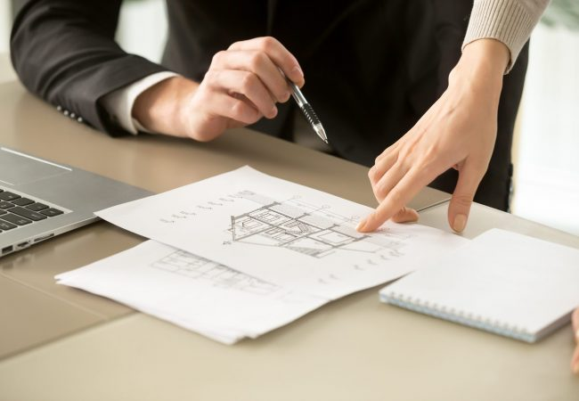 Close up view of two-story house construction project, architects discuss home building architectural plan, agents determine price of real estate object for sale, property value estimation appraisal